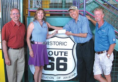 Courtesy -- Pictured left to right are: Historic Route 66 Association of Arizona Executive Vice President Tom Spear; Vicki Hoag representing Concerned Citizens of Valle Vista; Historic Route 66 Association of Arizona Founder and President Emeritus Angel Delgadillo; and Glenn Hoag, also representing the CCVV.