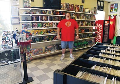 JC AMBERLYN/Miner -- David Nolin, owner of D&C Comics, stands inside his store Friday.<br /><br /><!-- 1upcrlf2 --><br /><br /><!-- 1upcrlf2 -->