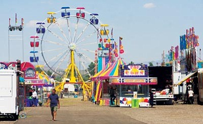 JC AMBERLYN/Miner -- The Mohave County Fair takes place this Thursday through Sunday at the Mohave County Fairgrounds in Kingman. On Tuesday, several people were at the fairgrounds getting ready for the annual event.