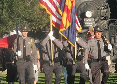 JC AMBERLYN/Miner -- Kingman Patriot Days, commemorating the American Veterans Traveling Tribute Wall was held at Locomotive Park in Kingman Tuesday evening. Here, the Mohave County Sheriff's Office posts colors. <br /><br /><!-- 1upcrlf2 --><br /><br /><!-- 1upcrlf2 -->