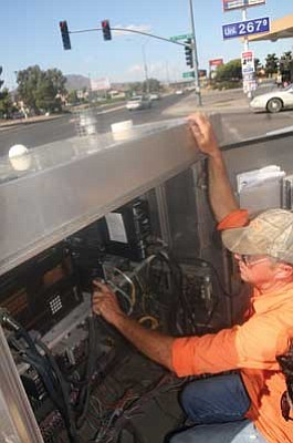 JC AMBERLYN/Miner<br /><br /><!-- 1upcrlf2 -->City Electrician Rick Pierce points out the wiring of traffic lights at the corner of Stockton Hill Road and Detroit Avenue Tuesday afternoon.