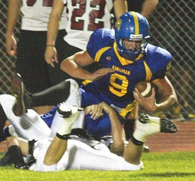 JC AMBERLYN/Miner<br /><br /><!-- 1upcrlf2 -->Kingman High's Dylan Smith is brought down after a carry Sept. 12 against Boulder Creek at KHS. Smith rushed for two touchdowns and threw for three more in Friday's 42-21 win over Goldwater in Phoenix.<br /><br /><!-- 1upcrlf2 --><br /><br /><!-- 1upcrlf2 -->