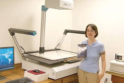 Mohave County/Courtesy<br /><br /><!-- 1upcrlf2 -->Mohave County Microfilm Records Technician Stephanie Ciofalo stands next to the new BookEye laser scanner in the County Recorder's Office Thursday in Kingman.