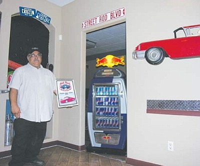 JAMES CHILTON/Miner<br /><br /><!-- 1upcrlf2 -->Vito Lombardo stands in the vestibule of the former Phoenix Grill building at 2215 Hualapai Mountain Road, Suite A. Lombardo is currently refitting the space to reopen it as the new Hot Rod Café, whose previous location was forced to close in 2007.