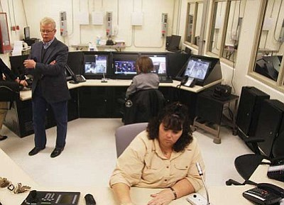 JC AMBERLYN/Miner<br /><br /><!-- 1upcrlf2 -->Sheriff Tom Sheahan (left) and several employees inside a surveillance area, where many locations are monitored in and around the jail.