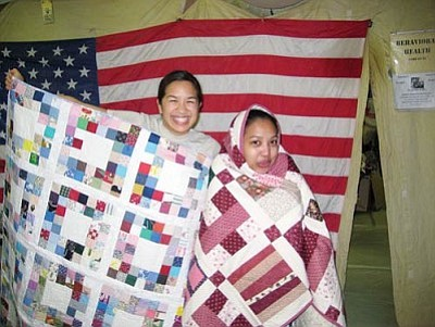 Courtesy<br /><br /><!-- 1upcrlf2 -->Members of U.S. Army Sergeant Christy Francis' unit in Helmand Province, Afghanistan, try out two of the quilts sent to them from Kingman by Francis' mother, Debbie. The quilts were donated by the people of Kingman to help keep the troops warm through the cold Afghanistan winters.