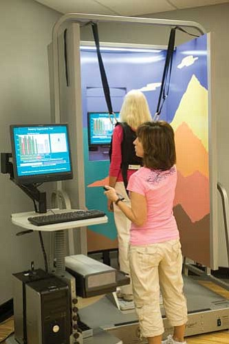 Courtesy<br /><br /><!-- 1upcrlf2 -->KRMC Balance Therapist Liz Briere, PT, tests a patient's equilibrium using special equipment at the new KRMC Dizziness and Balance Center.