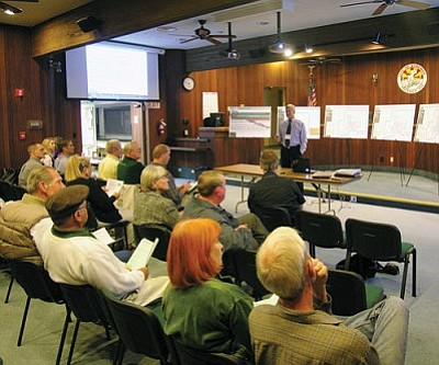 JAMES CHILTON/Miner<br /><br /><!-- 1upcrlf2 -->Consultant Bryan Patterson discusses a draft plan for the Kingman area's long-term transportation needs before an audience at the Kingman City hall Monday evening.