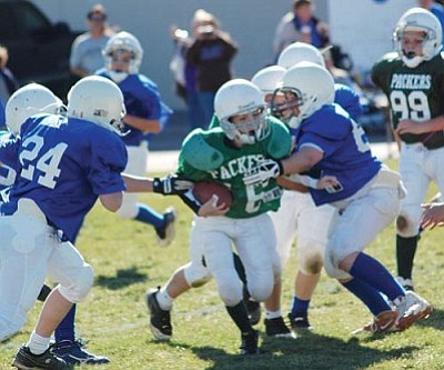 SHAWN BYRNE/Miner<br /><br /><!-- 1upcrlf2 -->The Packers' Patrick Taylor tries to get through the Cowboys' defense during the KYFL playoffs last Saturday at Kingman Middle School. The Packers held on for a 21-7 win and will meet the Vikings in the Super Bowl at 6 p.m. Saturday at Kingman High.<br /><br /><!-- 1upcrlf2 --><br /><br /><!-- 1upcrlf2 -->