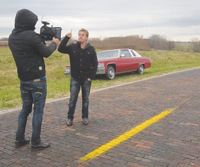 "Courtesy<br /><br /><!-- 1upcrlf2 -->In this photo uploaded to Facebook by Route 66 tour guide Dale Butel, Australian TV personality Grant Denyer talks to the camera along a stretch of Route 66 in Illinois. Denyer is touring Route 66 as part of a series for the Australian morning show ""Sunrise,"" and will be stopping through Kingman on Sunday afternoon.<br /><br /><!-- 1upcrlf2 -->"
