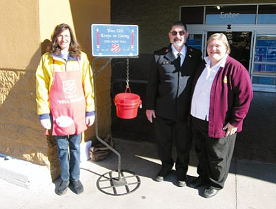 JAMES CHILTON/Miner<br /><br /><!-- 1upcrlf2 -->Local Salvation Army bellringer Angela Tackett (left) stands with Captains Les and Susan Spousta in front of Walmart at 3396 Stockton Hill Road. Bellringers like Tackett will be accepting donations through Christmas Eve.<br /><br /><!-- 1upcrlf2 -->