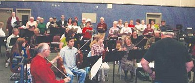 Courtesy<br /><br /><!-- 1upcrlf2 -->Members of the Mohave Community Orchestra and the Mohave Community Choir practice for their joint holiday concert in the band room at Kingman High School recently. The orchestra and choir are joining together in a rare combination concert, scheduled for 7 p.m. Dec. 11 in the KHS auditorium.<br /><br /><!-- 1upcrlf2 -->