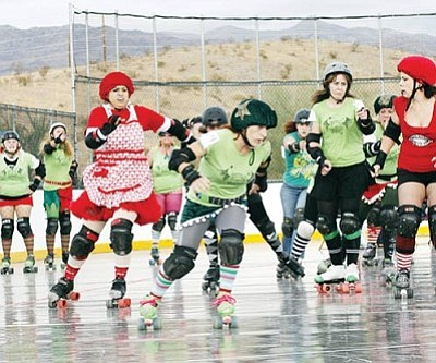 TRICIA HANKS/Courtesy<br /><br /><!-- 1upcrlf2 -->There was roller derby action in Lake Havasu City Dec. 18, which included members from Kingman's Belladonna Bruisers. The Bruisers joined up with the Roller Santas and fell just short in a comeback attempt, losing 84-83 to the Derby Elves.<br /><br /><!-- 1upcrlf2 --><br /><br /><!-- 1upcrlf2 -->