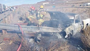 Courtesy<br /><br /><!-- 1upcrlf2 -->Firefighters with the Golden Valley fire department extinguish a burning truck after it struck a guardrail on Interstate 40 on Christmas Eve. The Department of Public Safety and the Kingman Fire Department also responded to the accident that claimed the life of a Kingman business owner.