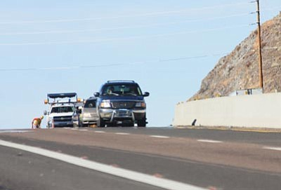 JC AMBERLYN/Miner<br>Construction workers make repairs on part of U.S. 93 at the top of Coyote Pass Tuesday as highway traffic drives by.<br /><br /><!-- 1upcrlf2 -->