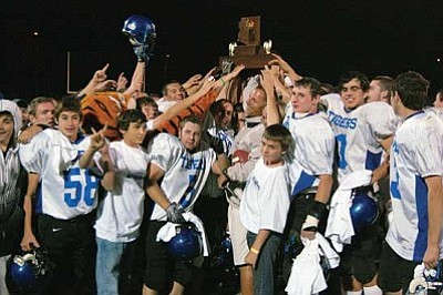 SHAWN BYRNE/Miner<br /><br /><!-- 1upcrlf2 -->The 2010 CAA 3A state champions Kingman Academy Tigers celebrate underneath their trophy after beating Sequoia 50-22 Nov. 19 in Phoenix. The Tigers earned the Miners' No. 1 spot for 2010's best sports memories.