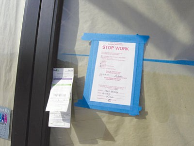 JAMES CHILTON/Miner<br /><br /><!-- 1upcrlf2 -->A city of Kingman stop work order is taped to the door of the Plaza Bonita restaurant at 1969 Beverly Ave. Friday morning. While renovation work is all but complete on the building, contractor Martin Dreager is working to finalize a detailed floor plan for the restaurant so he can finish installing the tables and kitchen equipment prior to opening later this month.<br /><br /><!-- 1upcrlf2 -->