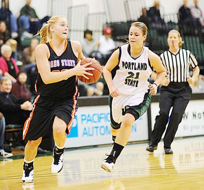 CRAIG CLARK/SportsPageMagazine.com<br /><br /><!-- 1upcrlf2 -->Lindsey Reed drives past Eryn Jones of Portland State during Idaho State's 89-75 loss to the Vikings Jan. 17 in Portland, Ore. Reed, a 2010 Kingman High graduate, scored 13 points for the Bengals.