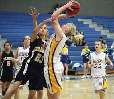 JC AMBERLYN/Miner<br /><br /><!-- 1upcrlf2 -->Kingman High had a tough time of it inside Friday against Goldwater, as shown by freshman Rachel Arave's attempt against Taylor Horne (23). Goldwater took the win, 60-36.