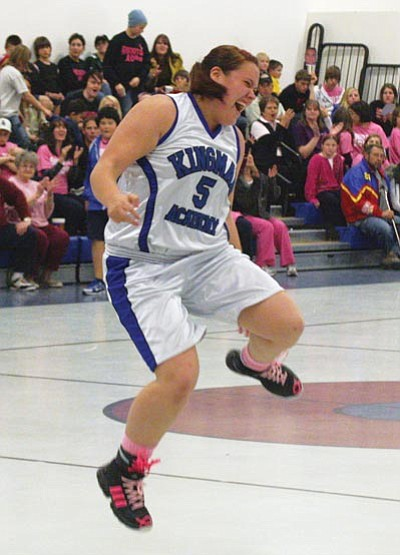 JC AMBERLYN/Miner<br> Kingman Academy's Laura Barnes celebrates after hitting a 3-pointer Saturday against Phoenix South Ridge.