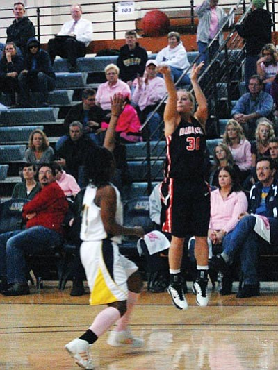 SHAWN BYRNE/Miner<br> Idaho State's Lindsey Reed puts up a 3-pointer over NAU Saturday in Flagstaff. Reed, a former Kingman High standout, scored 12 points for the Bengals in their 59-55 loss to the Lumberjacks.