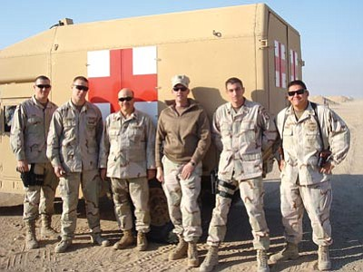 Courtesy<br> Joseph Dronchi (right) and his team in the desert in the Middle East.