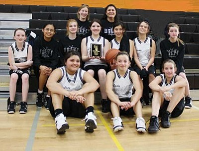 Courtesy<br /><br /><!-- 1upcrlf2 -->The seventh-grade White Cliffs Middle School girls basketball team wrapped up a perfect 14-0 season Feb. 5 with a 23-20 win over Thunderbolt for the area championship at WCMS.<br /><br /><!-- 1upcrlf2 -->