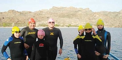 Courtesy<br /><br /><!-- 1upcrlf2 -->This group of swimmers is getting ready for the Escape from the Rock swim across the San Francisco Bay. From left, Jake Miyauchi, Terry Miyauchi, Aden Dunton, Eric Depner, Victoria Depner, Sofia Depner and Makayla Newberry get ready for a 1.4-mile swim across Lake Mohave.<br /><br /><!-- 1upcrlf2 -->