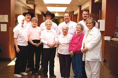 Courtesy<br> The Kingsmen are tough enough to wear pink in the fight against breast cancer. Back Row: Kingsmen Gordon Sanchez, Dustin Lewis, Ray Cullison and Cody Swanty. Front Row: Kingman Cancer Care Unit Members Lila Newton, Doris Panik, Dorothy Brown, Nancy Rembolt, Doris Power and Marty Adams.