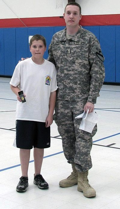 Courtesy<br> Bradon Spencer is shown with Pfc. Kenneth Johnson at KAOL.