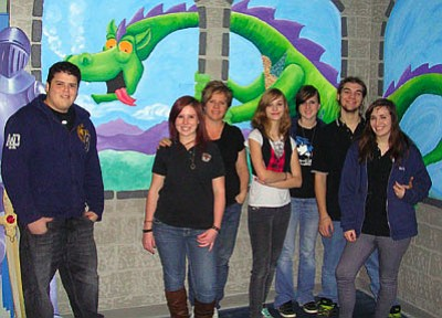 Mohave County/courtesy<BR> Young artists from Kingman Academy of Learning High School pose in front of a 3-D mural they completed for the new Visually Impaired Center at the Kingman Branch Mohave County Library on Thursday, Feb. 10. Pictured are (from left) Rodolfo Martin, who designed and painted the dragon, Tianna Hill, art teacher Donna McCarthy, Kayla Martin, Samantha Rezzetti, Zak Railey and Katie Poe. Student Sam Walker, not pictured, also worked on the mural.