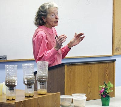JC AMBERLYN/Miner<br> Kingman Area Master Gardener Linda Reddick talks about soil preparation Friday at the Mohave County Library-Kingman. The Master Gardeners at the Library class provided the audience with information on weeds, seed selection, seed start and composting. The next class is from 9 a.m. to noon Saturday in the Hualapai Mountain Medical Center Conference Room. It will focus on Alternative Gardening. There will be another class at the library from 2-4 p.m. April 29 on Starting Seeds, Containers and Bugs. All programs are free.