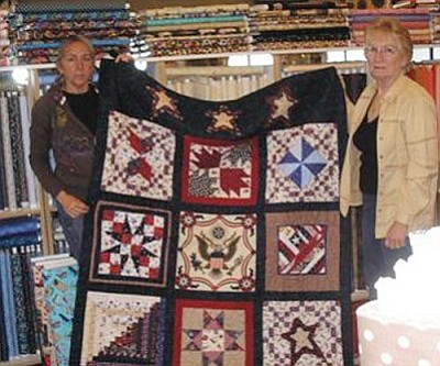 Courtesy<br /><br /><!-- 1upcrlf2 -->Connie Kettelhut, representing the Kingman Quilters Guild, presents a Quilt of Valor to Jordan Maynard's mother Angela Patterson last Wednesday.