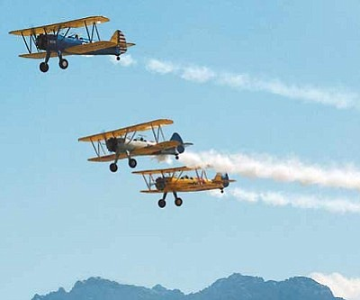 JC AMBERLYN/Miner<br>A formation of Stearmans flies over the runway during the last Kingman Air and Auto Show in 2007.<br /><br /><!-- 1upcrlf2 --><br /><br /><!-- 1upcrlf2 -->