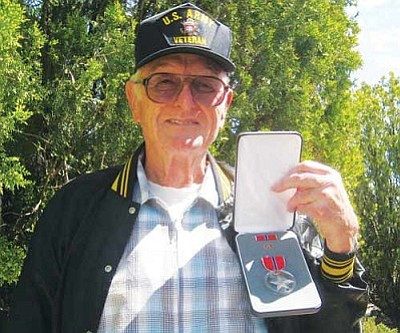 ERIN TAYLOR/Miner<br /><br /><!-- 1upcrlf2 -->89-year-old Kenneth Kelley poses with his Bronze Star, which arrived unexpectedly in the mail earlier this week.
