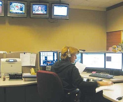 ERIN TAYLOR/Miner<br /><br /><!-- 1upcrlf2 -->A dispatcher works out of the call center at the Mohave County Sheriff's Office. The dispatchers were honored Thursday as part of National Public Safety Telecommunications Week.