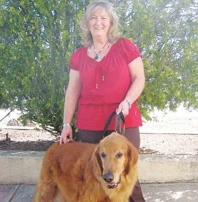 "ERIN TAYLOR/Miner<br /><br /><!-- 1upcrlf2 -->Golden Valley resident Brenda Muncy has written four books about her rescued pets as told through the animals' eyes. ""Noah's Best Friend"" is about the relationship between her golden retriever and husband Don, who passed away five years ago."