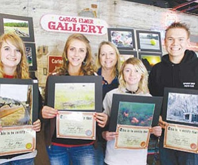 Courtesy<br /><br /><!-- 1upcrlf2 -->Last year's Carlos Elmer Photo Contest winners pose with their pictures and prizes. From left: Savanna Weninger, Maria Williams, Kate Arnold, Laura Boatman and Dakota Snider.<br /><br /><!-- 1upcrlf2 --><br /><br /><!-- 1upcrlf2 -->
