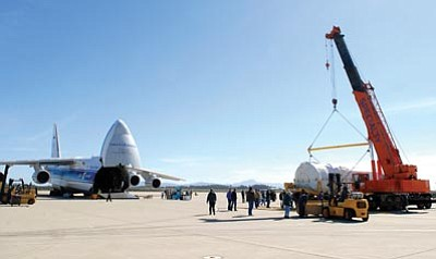 SRA ANDREW SATRAN/U.S.A.F. <br /><br /><!-- 1upcrlf2 -->Critical rocket components are loaded off an Antonov AN-124 aircraft and moved onto an awaiting flatbed trailer. The 30th Space Wing at Vandenberg Air Force Base serves as a strategic rocket and missile launch site for both unmanned government and commercial satellites.