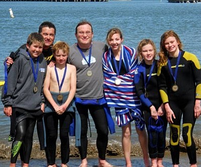 Courtesy<br /><br /><!-- 1upcrlf2 -->These seven swimmers from Kingman swam from Alcatraz Island to San Francisco on April 16. From left, Jacob Miyauchi, Terry Miyauchi, Aden Dunton, Eric Depner, Makayla Newberry, Victoria Depner and Sophia Depner.