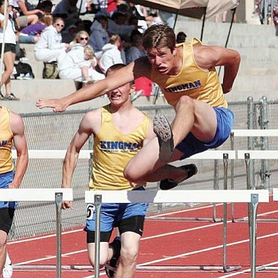 DAVID BELL/Today's News-Herald<br /><br /><!-- 1upcrlf2 -->Kingman High's Garrett Whitehead, right, clears a hurdle en route to winning his heat in the 110-meter hurdles at the Havasu Last Chance Qualifier track and field meet at Thunderbolt Middle School in Lake Havasu City April 27.<br /><br /><!-- 1upcrlf2 -->