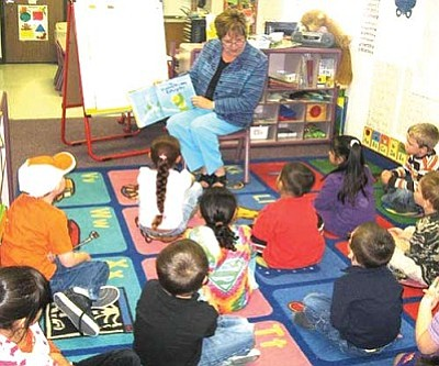 "Courtesy<br /><br /><!-- 1upcrlf2 -->City Councilwoman Janet Watson reads to preschool children at the WACOG Brian Meyers/Davis Head Start site as part of the ""Week of the Young Child"" celebrations."