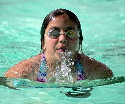 RODNEY HAAS/Miner <br /><br /><!-- 1upcrlf2 -->Rosana Volk, 9, practices her butterfly technique Thursday at Centennial Park pool. Volk is a member of the Kingman Dolphins swim team who just started their summer season this past week. This marks the 38th season the Dolphins have represented Kingman in the pool. <br /><br /><!-- 1upcrlf2 -->
