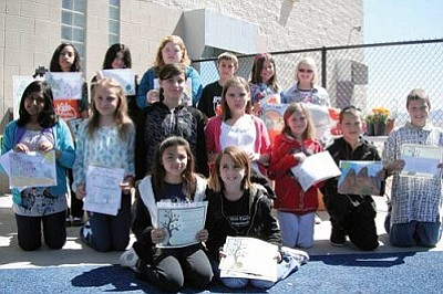 Courtesy<br /><br /><!-- 1upcrlf2 -->The Cerbat Garden Club's Arbor Day Poster Contest winners show off their artwork.