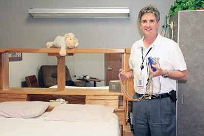 JC AMBERLYN/Miner<br /><br /><!-- 1upcrlf2 -->Mark Hopkins, the clinical supervisor for KRMC's Sleep Disorders Center, shows off a sleep-lab room where sleep apnea can be diagnosed.