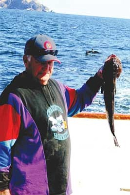 Courtesy<br /><br /><!-- 1upcrlf2 -->Former city of Kingman Police Chief Larry Butler holds his prize-winning big-fish catch of the day with a 25-inch ling cod caught off the Coronado Islands south of San Diego. The Parks and Recreation Department had 40 people take the trip.