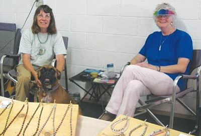 AHRON SHERMAN/Miner<br /><br /><!-- 1upcrlf2 -->Melissa Horn, Nadine Dorschler and Maya oversee the sale of different types of jewelry, including magnetic, at the Mohave Treasures Outlet.<br /><br /><!-- 1upcrlf2 -->