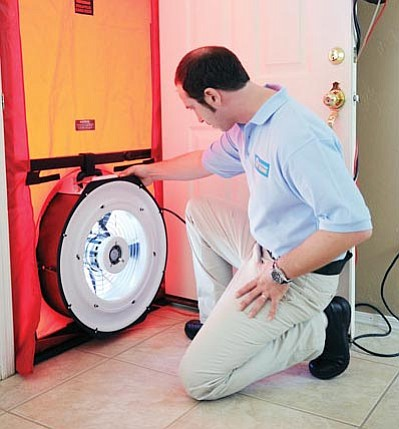 "UES/Courtesy<br /><br /><!-- 1upcrlf2 -->""Gabe"" tests a door for energy efficiency during a UES personalized home energy assessments. The company is offering the tests for $99. <br /><br /><!-- 1upcrlf2 -->"