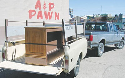 Courtesy<br /><br /><!-- 1upcrlf2 -->A recovered stolen antique table sits in the trailer of a truck parked next to A & P Pawn. A&P declined the opportunity to buy the table before two suspects were arrested.