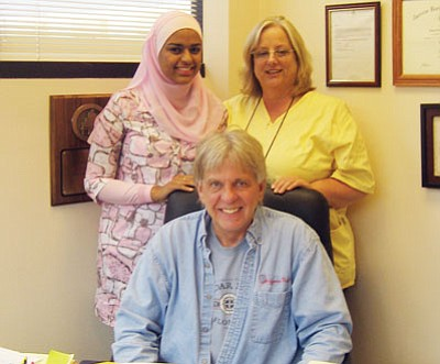 SUZANNE ADAMS/ Miner<br /><br /><!-- 1upcrlf2 -->Noura Mustafa (standing left), a second year medical student at University of Arizona who grew up in Kingman, finished her first residency in rural medicine with Dr. Kenneth Jackson (seated) at Kingman Regional Medical Center Friday. Jackson's assistant Leah Goldie (standing right) said staff will miss Mustafa.